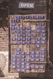Board with metal enameled plates of numbers Royalty Free Stock Photos