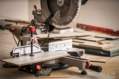 Board and miter saw Royalty Free Stock Photo
