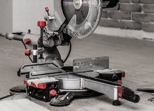 Board and miter saw Royalty Free Stock Photos