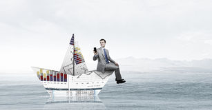 On board of paper ship  . Mixed media Stock Photography