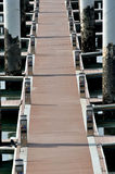 Board path on dock. Path on dock by board, shown as maritime activities, sport or entertainment, or different access and pah or way Stock Photos