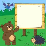 A board with a poster. Ridiculous animals gathered near the board where you can post any text Royalty Free Stock Photos