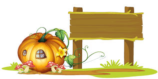 Board and pumpkin house Royalty Free Stock Photography