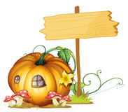 Board and pumpkin house Stock Images