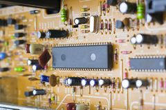 Board with radio components. Transitor, diode, capacitor, microcircuit, transformer, coil inside the VCR Stock Photography
