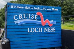 A board reading Cruise Loch Ness on the way to the famous Loch Ness stock photo