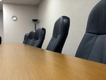 The Board Room. Table and chairs in an office conference room Royalty Free Stock Photography