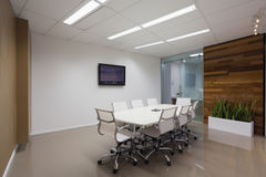 Board room with plasma screen. New board room with table chairs and plasma display Royalty Free Stock Photo