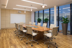 Board Room. With rustic wooden flooring,  meeting table and eames chairs Royalty Free Stock Photo