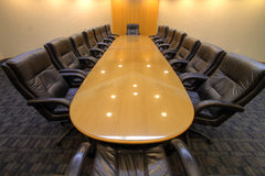 Board room table in conference room Royalty Free Stock Images