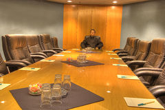 Board room table with one model. The board room table in a conference facility up close with one model Stock Photos