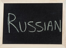 Board with RUSSIAN. A black board with a wooden frame and the word 'RUSSIAN' written in chalk Royalty Free Stock Photography