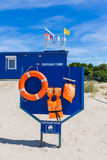 Board with safety equipment on the beach Stock Image