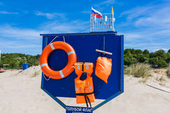 Board with safety equipment on the beach Stock Photo