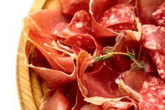 Board with salami and jamon. Board with thinly sliced salami and jamon stock images