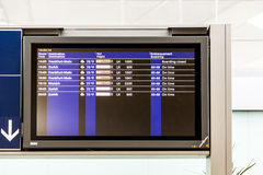 Board with the schedule of departures of planes indicates latest Stock Image