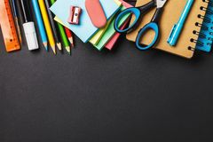 Board with school supplies and the copy of space below. How much is to bring together the child in school. Board with school supplies and the copy of space below stock images