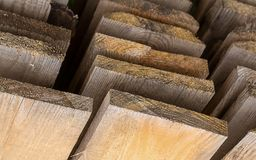 Board stack unpainted warehouse view from below upward perspective, background pattern lumber. Board stack unpainted warehouse view from below upward perspective Royalty Free Stock Image