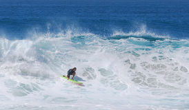 Board surfer riding a wave at Aliso Beach in Laguna Beach, California. Stock Image