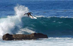 Board surfer riding in a wave at Laguna Beach, CA. Stock Images