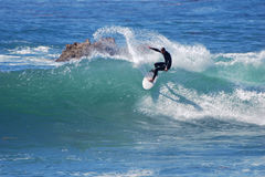 Board surfer riding in a wave at Laguna Beach, CA. Royalty Free Stock Photography