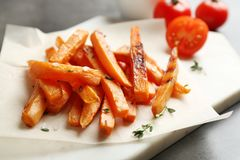 Board with sweet potato fries on grey table. Closeup royalty free stock photos