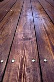 Board table in the perspective. Varnished table from the rough boards Stock Photo