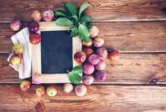 Board for text with fresh plums Royalty Free Stock Images