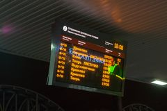 Board with the time of departure of commuter trains Stock Photography