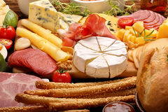 Board of various types of cheese and appetizers set Stock Images