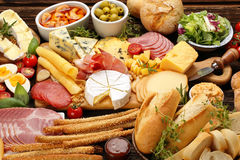 Board of various types of cheese and appetizers set Stock Photo