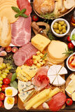 Board of various types of cheese and appetizers set Stock Image