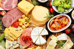 Board of various types of cheese and appetizers set Royalty Free Stock Image