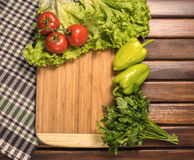 Board with vegetables on table. Toning warm Stock Photo