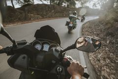 On board view of motorcycles turning on the road, from the point stock photos