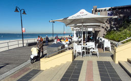 Board walk cafe botany bay. Board walk cafe brighton le sands, botany bay with the beach on the left and people enjoying breakfast Stock Image
