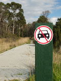 Board walk with a car prohibited sign at parkland. Melbourne 2017 Royalty Free Stock Images