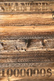Board wanted. In old brown planks brought together stock photo