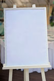 Board, which stands on the easel with drawing-paper. For guest`s greetings Royalty Free Stock Photo