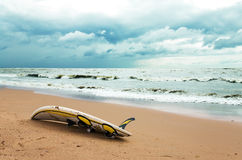 Board for windsurfing on the beach. And cloudy sky Stock Photo