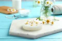 Free Board With Floral Candle And Chamomile On Table Stock Images - 151179324