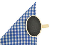 Board with wooden peg on checked cloth Stock Photos