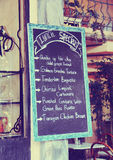 Board with the words menu in the restaurant. vintage effect Royalty Free Stock Photography