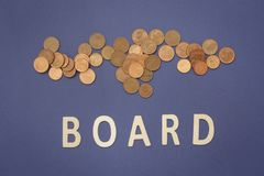Board written with wooden letters on a blue background. To mean a business concept Stock Photo