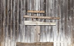 Boarded gate. In an old building made of pine wood, closeup royalty free stock image