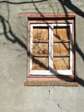 Boarded Shut Building Window with Tree Shadow. Royalty Free Stock Photos