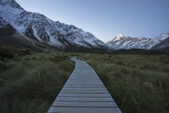 Boarded trail section in Hooker Valley on a track leading to Aoraki, Mount Cook Royalty Free Stock Photo