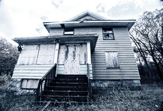 A boarded up, abandoned house Stock Photo