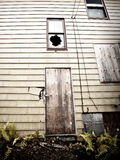 A boarded up, abandoned house Royalty Free Stock Image
