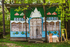 Boarded-up children`s Playhouse in the yard of the kindergarten. Boarded up the house for children to play Royalty Free Stock Images